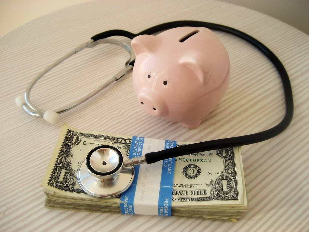 Image of medical devices and money