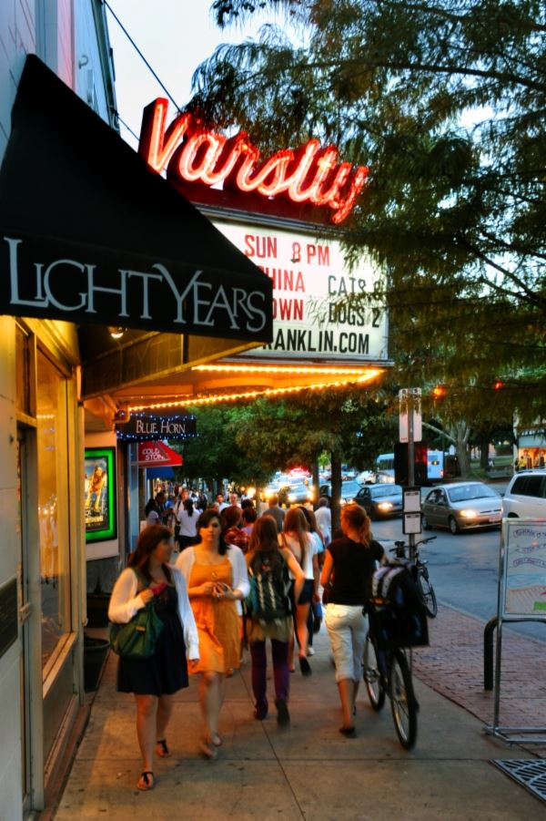People walking by Historic Varsity Theatre