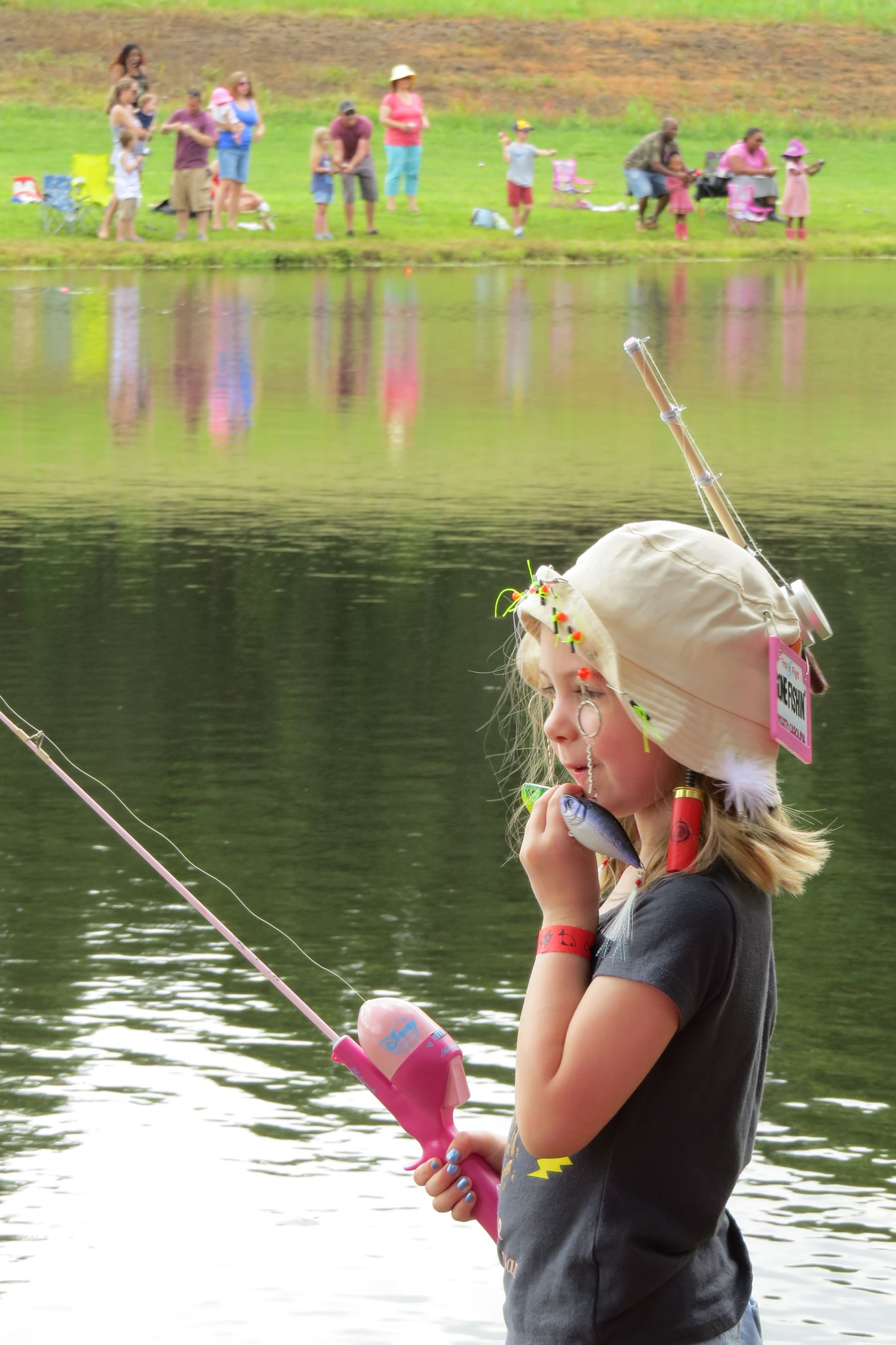 Girl in hat fishing