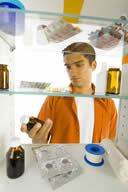 Teen Looking in Medicine Cabinets